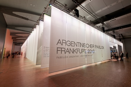 exhibition hall: FRANKFURT, GERMANY - OCTOBER 8 2010: Visitors inside the Argentine Guest of Honour Pavilion at the Frankfurt Book Fair. Argentina was the guest of Honour in 2010.