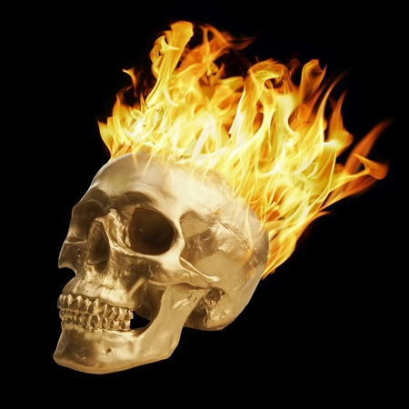 Golden skull with blazing fire photo