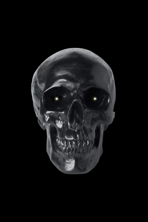 eye socket: Black skull with glowing eyes isolated on black background Stock Photo
