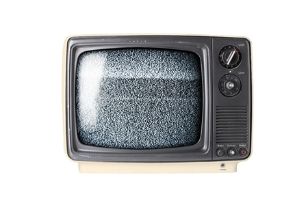 Vintage TV set isolated on white background with static photo