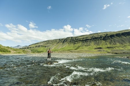 Man fishing for salmon in a beautiful surrounding
