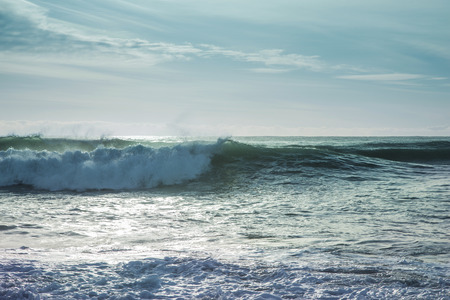 Beautiful surf in the early morning with waves coming in Stock Photo