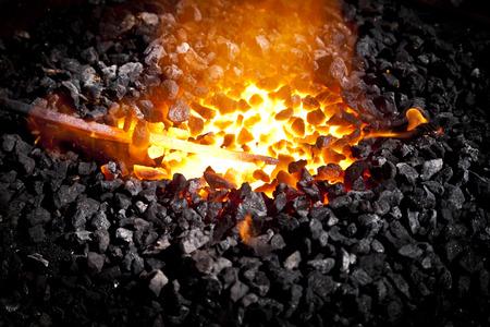 coals: Conceptual image of a hot iron in burning coals