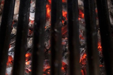 grates: Flaming hot cooking grates- selective focus