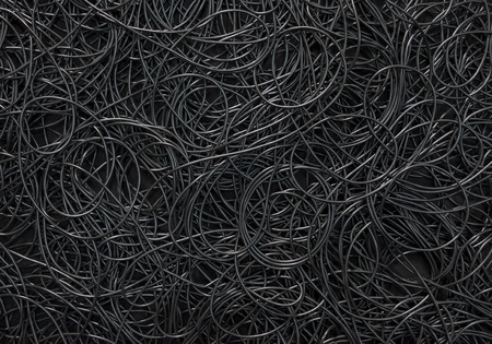 wire mess: Background covered with a pile of electric cords filling the entire frame Stock Photo