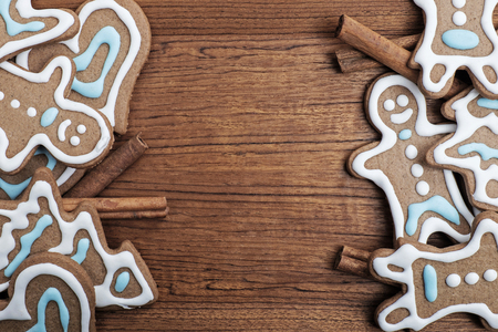 gingerbread cookies: Gingerbread cookies with cinnamon sticks on a wooden background Stock Photo