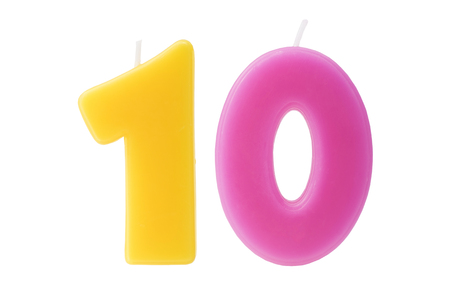 age 10: Colorful birthday candles in the form of the number ten on white background Stock Photo