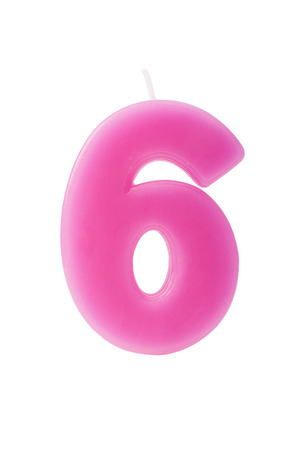 number six: Pink birthday candle in the form of the number six on white background