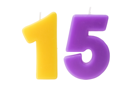 fifteen year old: Colorful birthday candles in the form of the number fifteen on white background