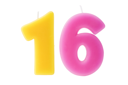 sixteen: Colorful birthday candles in the form of the number sixteen on white background