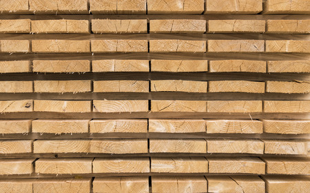 trimmed: Trimmed and debarked timber planks piled up at a sawmill