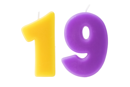 nineteen: Colorful birthday candles in the form of the number nineteen on white background Stock Photo