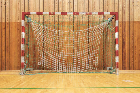 fitness goal: The soccer goal in an old multisport gymhall Stock Photo