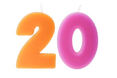 20th: Colorful birthday candles in the form of the number twenty on white background