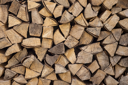 neatly: Stack of neatly arranged firewood ready for the winter