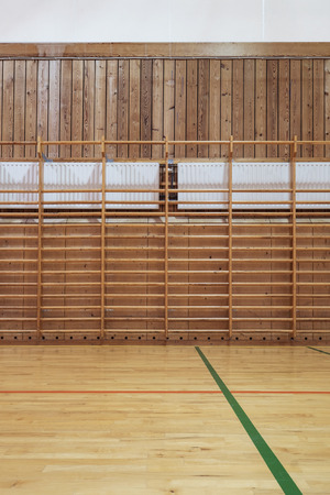 wall bars: Timber wall bars in old gymhall Stock Photo