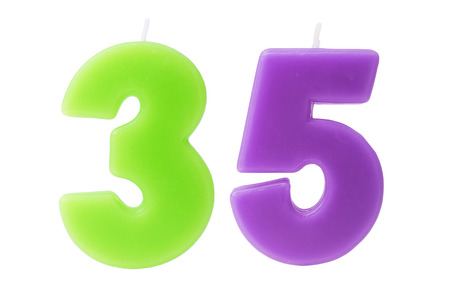 3 5 years: Colorful birthday candles in the form of the number 35 on white background Stock Photo