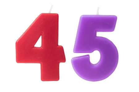age 5: Colorful birthday candles in the form of the number 45 on white background Stock Photo