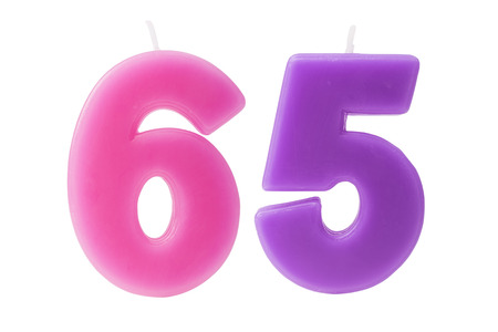 5 6 years: Colorful birthday candles in the form of the number 65 on white background