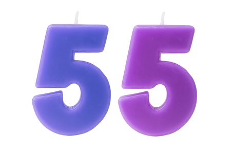 55 years old: Colorful birthday candles in the form of the number 55 on white background