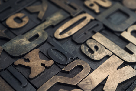 Collection of various wood type letters for printing with selective focus