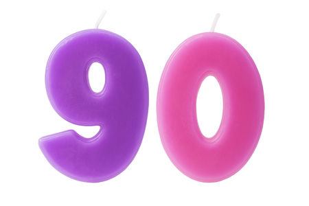 nine years old: Colorful birthday candles in the form of the number 90 on white background