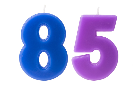 eight years old: Colorful birthday candles in the form of the number 85 on white background