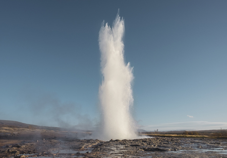 The famous Strokkur hot spring geyser erupting in Iceland Stock Photo