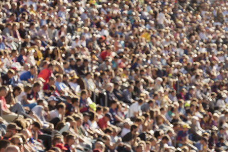 Blurred out people attending an event at an outdoor stadium Stock Photo