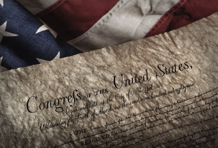 bill of rights: U.S. Bill of rights document on an old and worn US flag