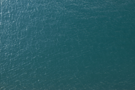 ocean background: Vast blue ocean background with moderate waves looking straight down