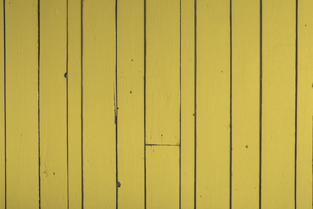 Reclaimed: Yellow reclaimed timber wall backgound Stock Photo