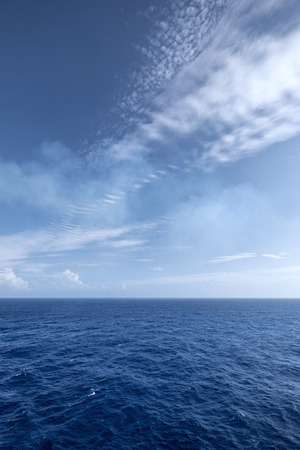 Vast blue ocean and sky background with moderate waves Stock Photo