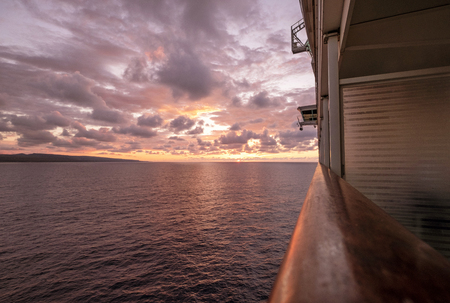 Cruise ship sailing towards a magnificent sunset Archivio Fotografico