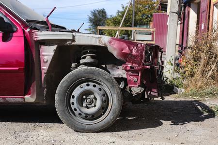 Dismantled Front of a Red Car. Red Car After the Crash. Banco de Imagens