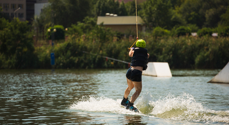Young Woman Study Wakeboarding on a Lake Banco de Imagens