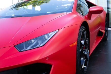 Miami, FL, USA - April 16, 2019: Luxury Red Lamborghini  Parked In The Street Of Broward.  The Lamborghini  is an SUV manufactured by Italian car manufacturer Редакционное