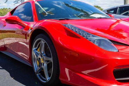 Miami, FL, USA  April 16, 2019: Red Ferrari  parking on the side road. Ferrari Luxury Italian sports car