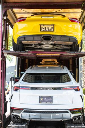Miami, FL, USA - April 16, 2019: New Luxury Italian Sport Cars in a Big Delivery Truck for Batch Delivery to Dealership.
