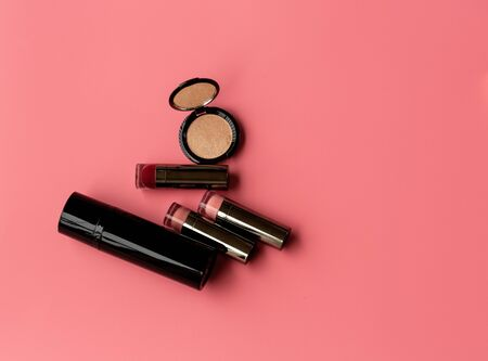 Set of Professional Cosmetic:Various of  Lipstics, make up shade or Illuminate Cheeks on a Pink Background. Top View. Copy Space for text