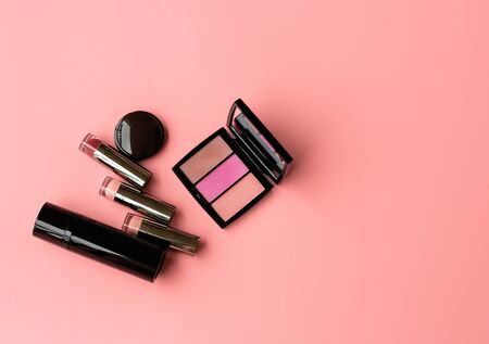 Set of Professional Cosmetic:Various of  Lipstics, make up shade  on a Pink Background. Top View. Copy Space for text Stock fotó