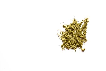 Matcha powder explosion on white background. Top view.  Japanese Culture. Popular Healthy Tea.