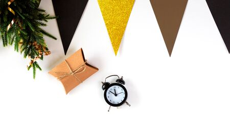 Christmas Decoration, handmade craft paper gift box, alarm clock on White Background. Winter Christmas Holiday Concept. Happy New Year Flat Lay composition Banco de Imagens