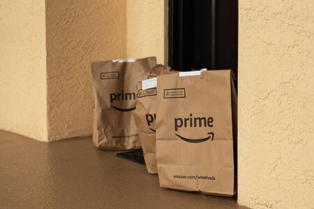 Miami, FL, USA - August 6, 2019:  Amazon Prime packages at apartment door.Amazon is an online company and is the largest retailer in the world.