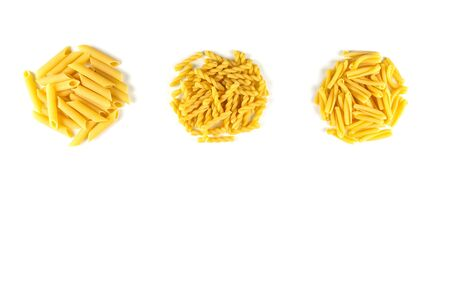 Various kind of raw Italian pasta isolated on white background. Food and drink concept , uncooked pasta on white background. Top view. Copy Space