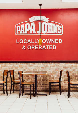 Inside interior of Papa Johns Pizza American restaurant . It is the fourth largest pizza delivery chain in the US, headquarters in Jeffersontown, Kentucky Редакционное