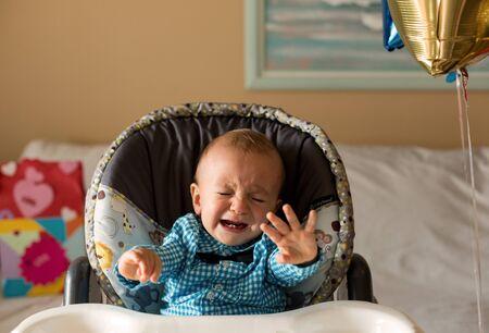 One year old cute boy crying.