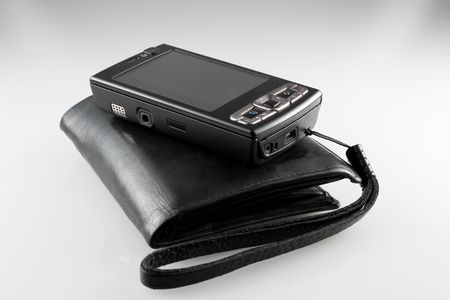 Black purse and mobile phone on white background Stock Photo - 4787146