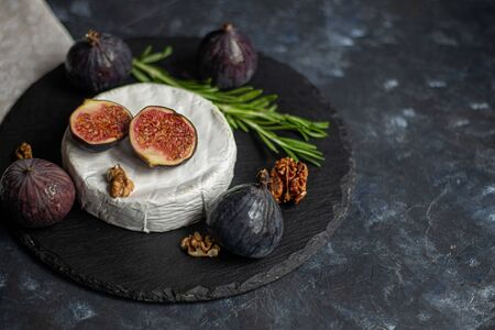 Ripe, beautiful, purple figs. Sweet and juicy. Mediterranean fruit is very healthy. You can jerk and cook jam. There is empty space on a dark copyspace background. Food for vegetarians.