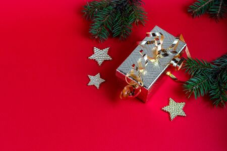 Christmas composition. New Year. Gifts, fir branches, red background. Christmas, winter, new year concept. Flat lay, top view, copy space. 写真素材